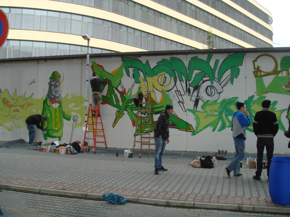 Graffiti artists painting a wall